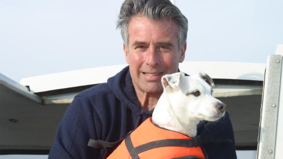 """More than anything else, Selby -- pictured with his dog, Bart -- wants to emphasize how much enjoyment sailing has given him.  """"Sailing is one of the great freedoms there is, you don't need a license,"""" said Selby. """"The marvel of sailing is that is shows us how little we need, and how lucky we are. """""""