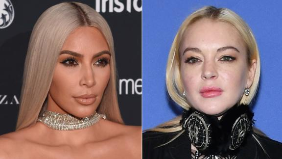 "When Lindsay Lohan, right, said in January 2018 that she was confused by Kim Kardashian West's new hairstyle, the TV reality star clapped back with ""You know what's confusing..... Your sudden foreign accent."""