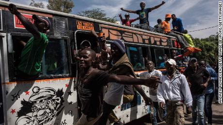 "Jubilant opposition supporters demonstrate prior to a mock ""swearing-in"" ceremony of presidential candidate Raila Odinga on January 30."