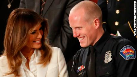 First lady Melania Trump talks with Albuquerque Police Officer Ryan Holets and this wife before the State of the Union address to a joint session of Congress on Capitol Hill in Washington, Tuesday, Jan. 30, 2018. (AP Photo/Pablo Martinez Monsivais)