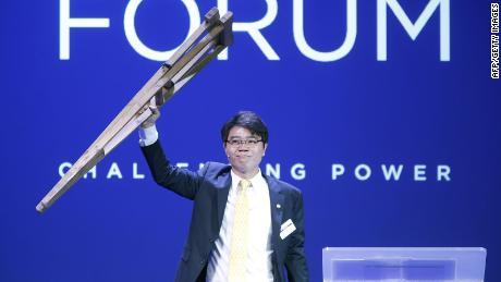 "President of NGO ""Now Action and Unity for Human Rights"", Ji Seong-ho of North Korea holds up wooden crutches at the Oslo Freedom Forum in Oslo, on May 26, 2015."