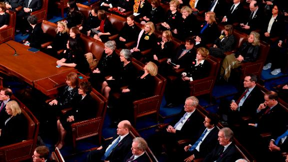 Democratic Senators, House representative, and guests sit and look on as US President Donald Trump delivers the State of the Union address at the US Capitol in Washington, DC, on January 30, 2018. (Photo credit should read SAUL LOEB/AFP/Getty Images)