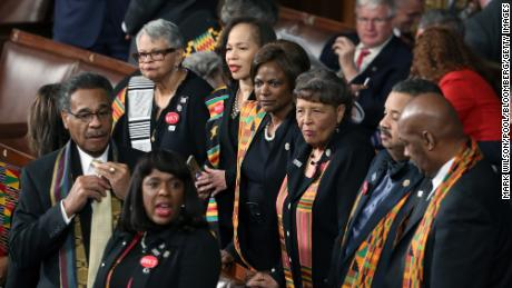 Members of Congressional Black Caucus wear black clothing and Kente cloth in protest ahead of a State of the Union address to a joint session of Congress at the U.S. Capitol in Washington, D.C., U.S., on Tuesday, Jan. 30, 2018. President Donald Trump plans to promote the Republican tax overhaul he signed into law in his first State of the Union speech on Tuesday night, but fiscal headwinds mean hes likely to have less legislative success in his second year in office. Photographer: Mark Wilson/Pool via Bloomberg