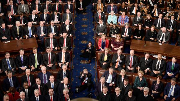 Cabinet members, members of Congress and Supreme Court justices listen as President Donald Trump delivers the State of the Union address on January 30, 2018.