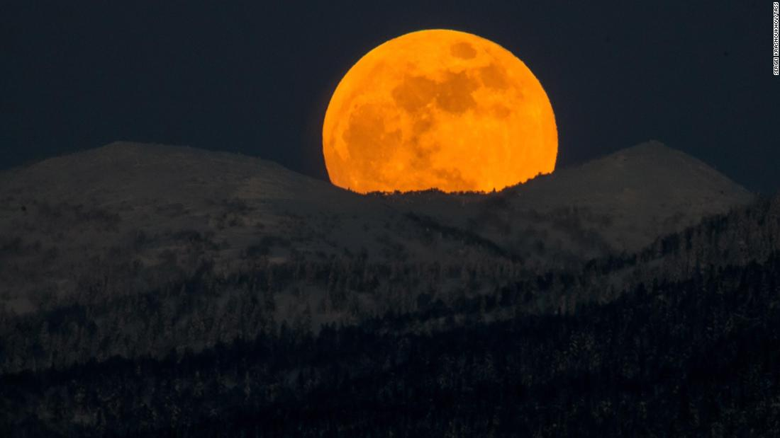 The moon rises over hills near the city of Yuzhno-Sakhalinsk on Sakhalin Island in Russia's Far East.
