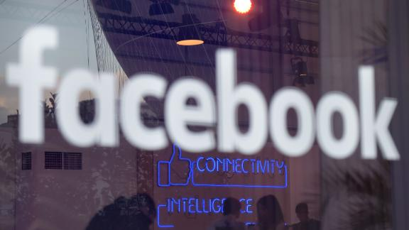 """This file photo taken on February 24, 2016 shows the """"Facebook""""-logo pictured on the sidelines of a press preview of the so-called """"Facebook Innovation Hub"""" in Berlin."""