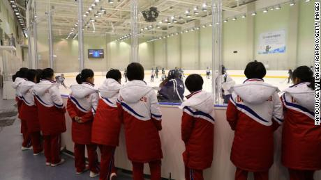 North Korea's women's ice hockey players watch South Korea's women's team train on January 26, 2018.