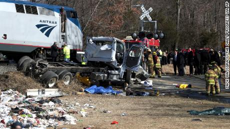 Emergency personnel work at the scene of a train crash involving a garbage truck in Crozet, Va., on Wednesday, Jan. 31, 2018. An Amtrak passenger train carrying dozens of GOP lawmakers to a Republican retreat in West Virginia struck a garbage truck south of Charlottesville, Va. No lawmakers were believed injured, but it at least one person in the truck was said to be seriously injured.  (Zack Wajsgrasu/The Daily Progress via AP)