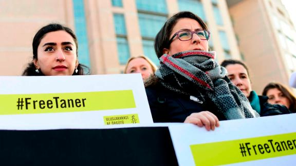 A group of human rights activists gather outside an Istanbul courthouse on Wednesday.