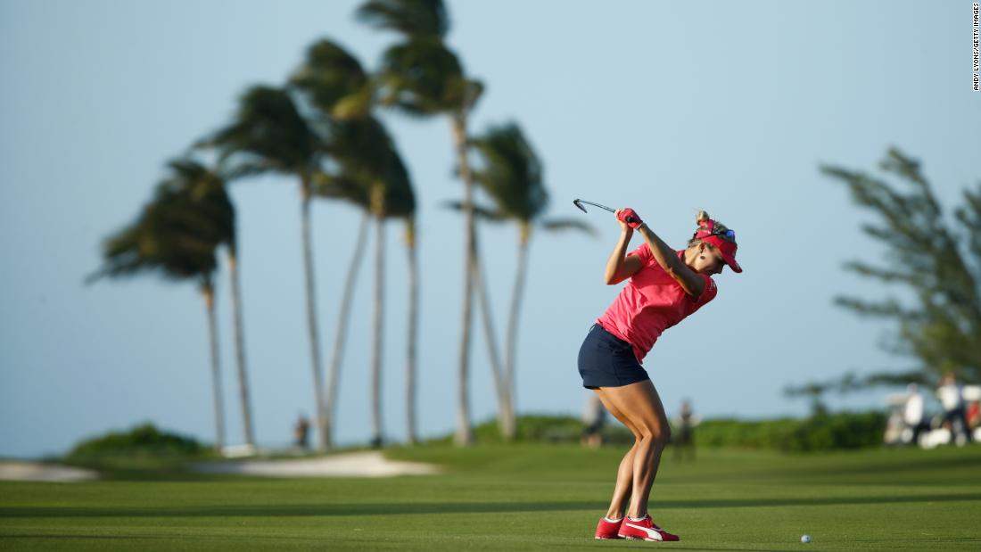<strong>In paradise:</strong> Lexi Thompson plays in strong winds at the Pure Silk Bahamas LPGA Classic at the Ocean Club Golf Course on Paradise Island.