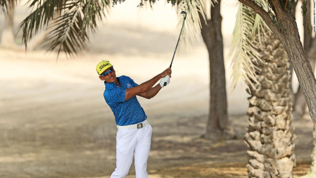 <strong>In the shade: </strong>Spain's Rafa Cabrera Bello hides from the sun sun during January's Dubai Desert Classic.
