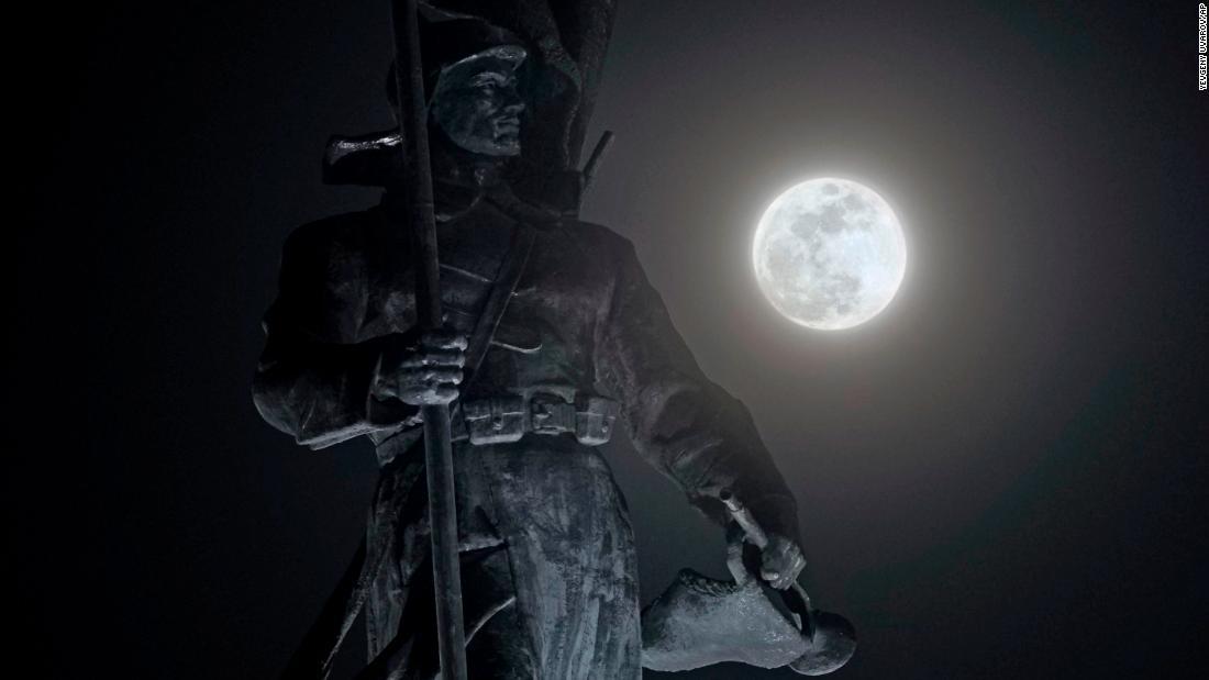 The full moon shines over a monument in Vladivostok, Russia.