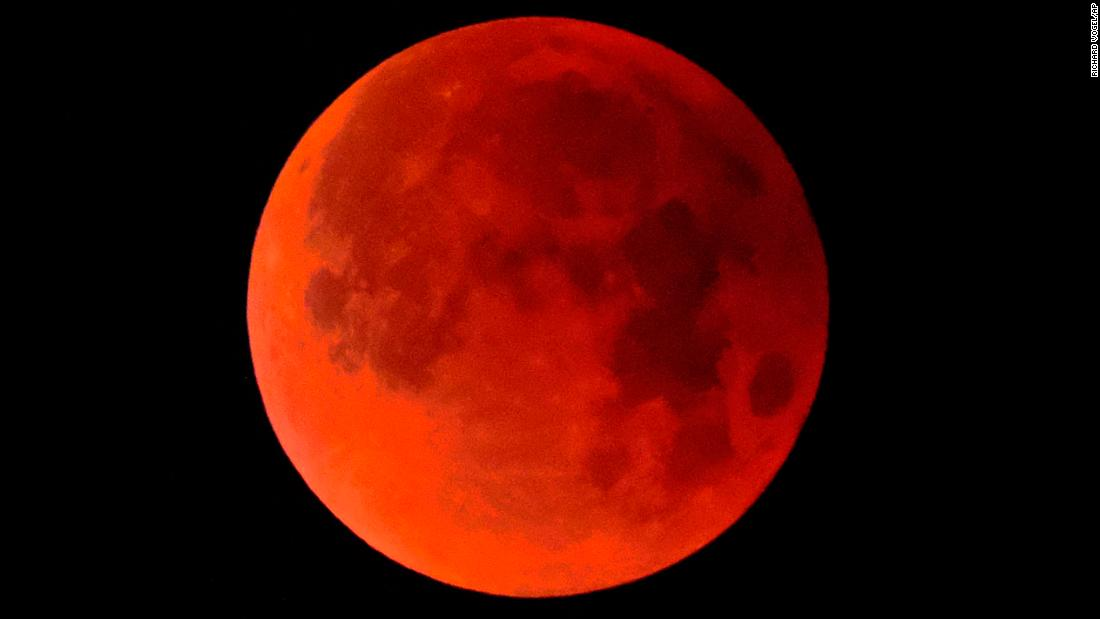 "A ""super blue blood moon"" is seen on Wednesday, January 31, 2018, over Los Angeles. The <a href=""https://www.cnn.com/2018/01/26/world/super-blue-blood-moon-guide-2018-intl/index.html"" target=""_blank"">rare phenomenon</a> occurs when a supermoon, a blue moon and a total lunar eclipse all occur at the same time."