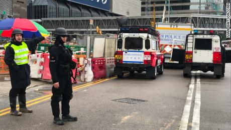 Police are present Wednesday outside the Hong Kong construction site where the explosive was found.