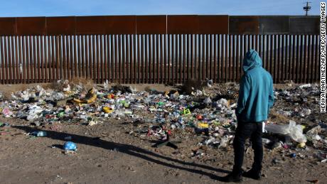 A man stands near the border wall between Mexico and the United States, in Ciudad Juarez, Chihuahua state, Mexico, on January 19, 2018.  The Mexican government reaffirmed on January 18, 2018 that they will not pay for US President Donald Trump's controversial border wall and warned that the violence in Mexico is also the result of the heavy drug consumption in the United States. / AFP PHOTO / Herika MARTINEZ        (Photo credit should read HERIKA MARTINEZ/AFP/Getty Images)