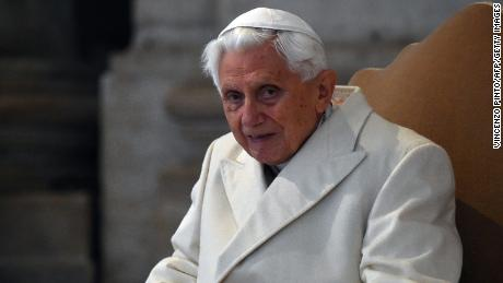 "Pope Emeritus Benedict XVI arrives at St Peter's basilica before the opening of the ""Holy Door"" by Pope Francis to mark the start of the Jubilee Year of Mercy, on December 8, 2015 in Vatican. Pope Francis marks the start of an extraordinary Jubilee year for the world's 1.2 billion Catholics by opening a ""Holy Door"" in the walls of St Peter's basilica. At 9.30 am (0830 GMT), the Argentinian pontiff will pronounce the words ""Aperite mihi Porta Iustitiae"" -- Latin for ""open to me the gates of justice"" -- and the door, which is normally bricked up, will be opened.    AFP PHOTO / VINCENZO PINTO / AFP / VINCENZO PINTO        (Photo credit should read VINCENZO PINTO/AFP/Getty Images)"