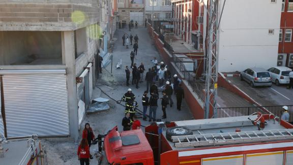 Police and firefighters work at a scene of a rocket attack, fired from inside Syria, in the border town of Kilis, Turkey, Tuesday, Jan. 30, 2018. Turkey had launched a military offensive against the nearby Kurdish enclave of Afrin on Jan. 20 to drive out the Syrian Kurdish People's Protection Units, or YPG, which is says are an extension of the outlawed Kurdish rebels inside Turkey. (AP Photo/Lefteris Pitarakis)