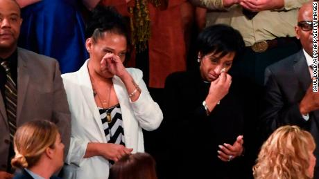 Robert Mickens, Elizabeth Alvarado, Evelyn Rodriguez and Freddy Cuevas, parents of children who were murdered by MS-13 are acknowledged as US President Donald Trump delivers the State of the Union address at the US Capitol in Washington, DC, on January 30, 2018.  / AFP PHOTO / SAUL LOEB        (Photo credit should read SAUL LOEB/AFP/Getty Images)