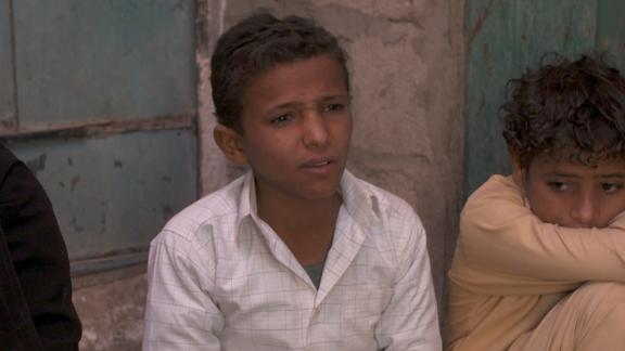 Younis, 13, says he learned to use a machine gun as a young chid.
