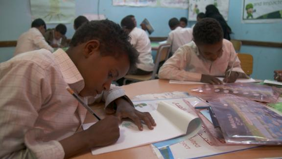 Boys at the rehabilitation center for former child soldiers sketch their memories.