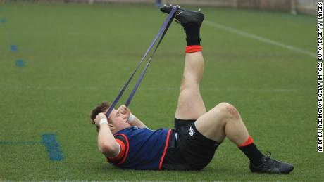 Joe Heyes stretches before training