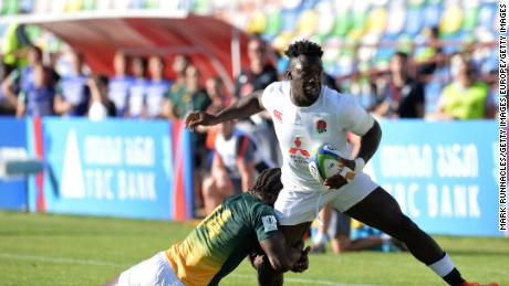 Gabriel Ibitoye of England is tackled by Yaw Penxe of South Africa during the World Rugby U20 Championship Semi Final match between England and South Africa at Mikheil Meskhi Stadium on June 13, 2017 in Tbilisi, Georgia. (Photo by Mark Runnacles/Getty Images)