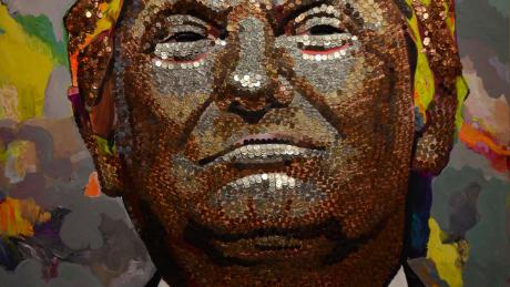 A giant portrait of Trump made from hundreds of pennies