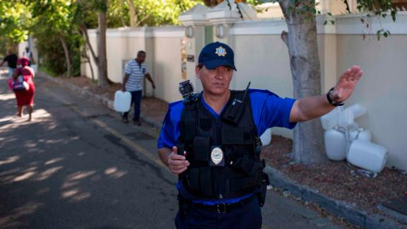 A police officer controls water collection on February 1.