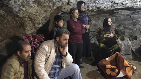 Turkish bombs drive families into caves