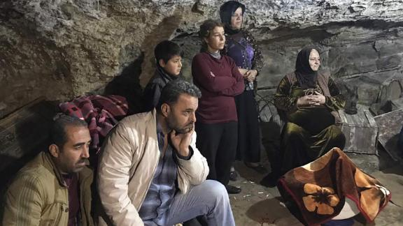 Families take shelter underground in Afrin, Syria on Monday, January 29, after the town was shelled.