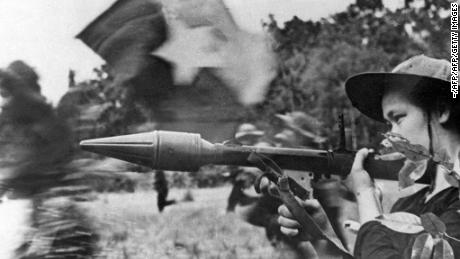 A female Viet Cong soldier seen in action with an anti-tank gun during the Tet Offensive in early 1968.