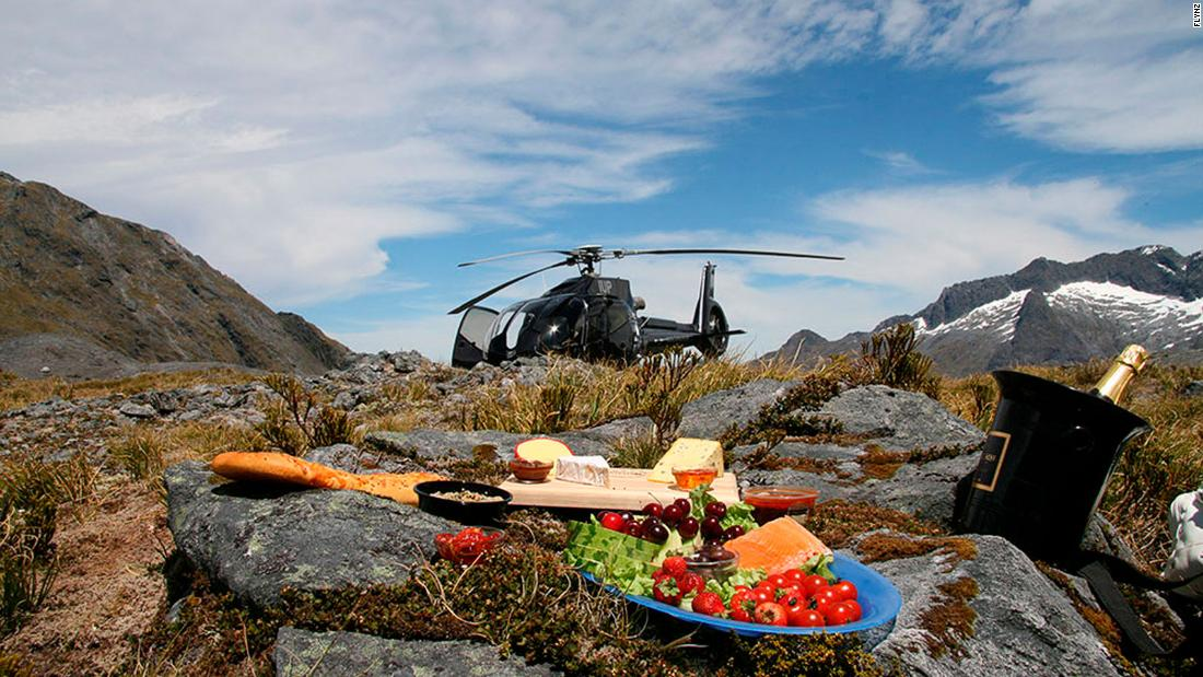 <strong>Heli-picnic in New Zealand: </strong>Could there be a better way of taking in the incredible views of Lake Wakatipu and the Southern Alps of New Zealand than enjoying a champagne picnic on a majestic peak?