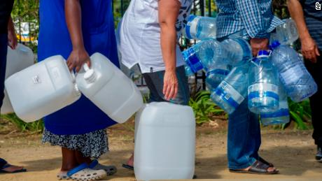 "People queue to collect water from a natural spring outlet in the South African Breweries in Cape Town, Tuesday Jan. 23, 2018. Tourists in the city famously perched near two oceans are being asked to flush the toilet as little as possible and swim in the ocean instead of pools ""and maybe even spare yourself a shower"", as a harsh drought may force South Africa's showcase city to turn off most taps. (AP Photo)"