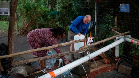 People collect water on February 1.