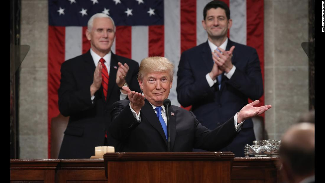 "US President Donald Trump gestures during <a href=""https://www.cnn.com/interactive/2018/01/politics/state-of-the-union-cnnphotos/"" target=""_blank"">his first State of the Union address</a> on Tuesday, January 30. Trump, now a year into his presidency, declared that the ""state of our union is strong because our people are strong. Together, we are building a safe, strong and proud America."""