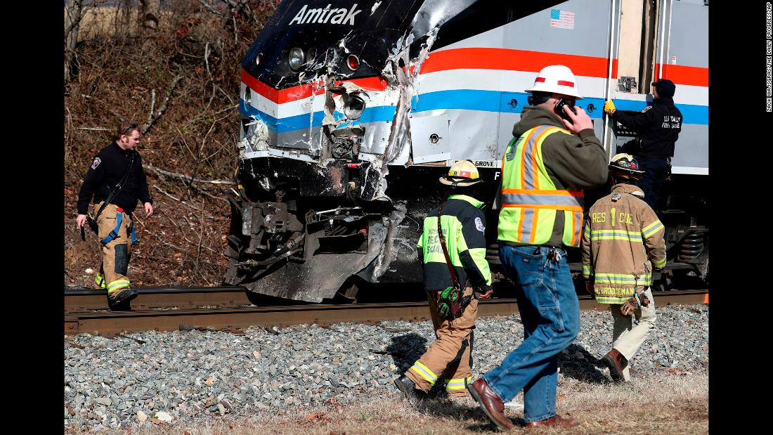 "Emergency personnel inspect the lead engine of an Amtrak train that <a href=""https://www.cnn.com/2018/01/31/politics/congress-train-accident/index.html"" target=""_blank"">struck a garbage truck</a> in Crozet, Virginia, on Wednesday, January 31. The train was carrying dozens of Republican members of Congress when the truck crossed its path. The lawmakers were OK after the crash, but the passenger inside the truck was killed and the driver was injured. The crash is <a href=""https://www.cnn.com/2018/02/01/politics/republican-train-crash-investigation/index.html"" target=""_blank"">under investigation.</a>"