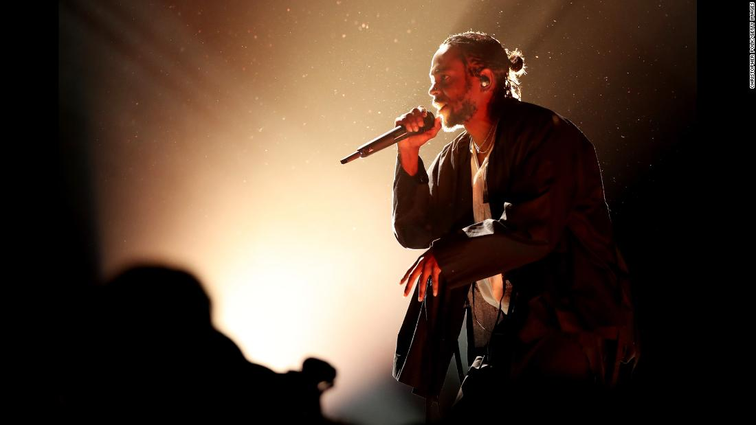 "Rapper Kendrick Lamar performs at the start of <a href=""https://www.cnn.com/2018/01/28/entertainment/gallery/grammys-2018-show-highlights-winners/index.html"" target=""_blank"">the Grammy Awards</a> on Sunday, January 28. He won five Grammys, including best rap album and best rap song."