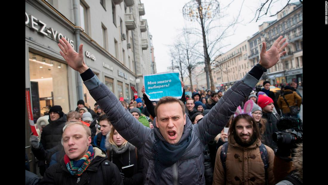 "Russian opposition leader Alexei Navalny, center, attends an anti-government rally in Moscow on Sunday, January 28. Navalny, a longtime critic of President Vladimir Putin, <a href=""https://www.cnn.com/2018/01/28/europe/russian-protests-navalny-office-intl/index.html"" target=""_blank"">was arrested and later released.</a>"