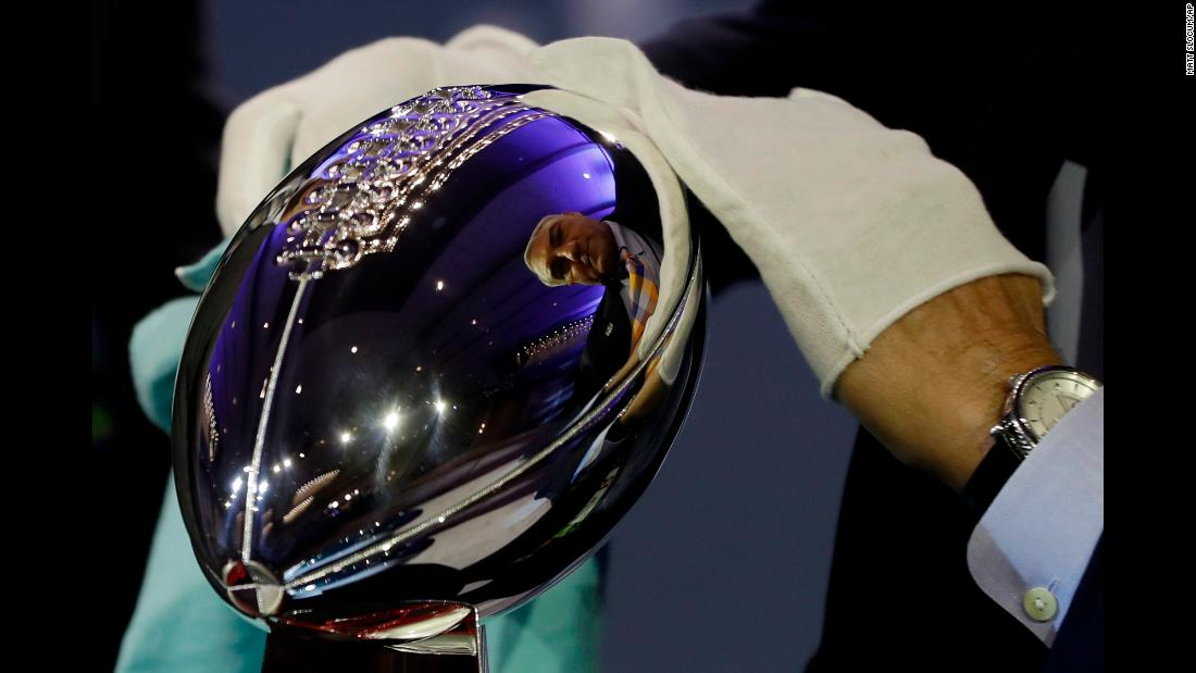 The Vince Lombardi Trophy, awarded annually to the NFL's Super Bowl champions, is wiped down before a news conference in Minneapolis on Wednesday, January 31. Super Bowl LII is Sunday, February 4.