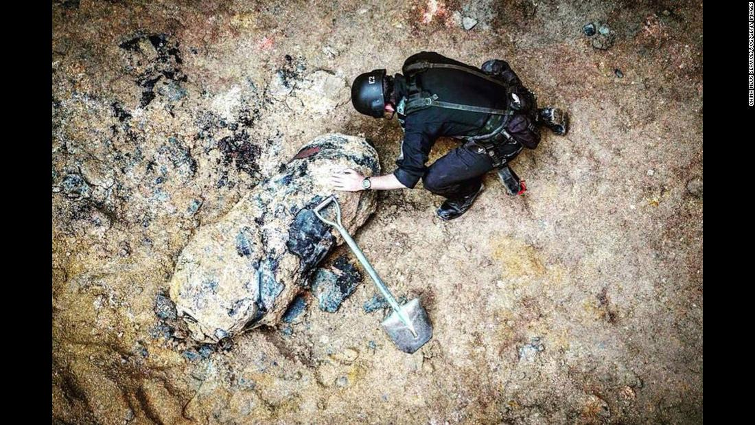 "A police officer examines a large World War II-era bomb that was discovered Saturday, January 27, during construction near the Hong Kong Convention Center. Authorities <a href=""https://www.cnn.com/2018/01/28/world/hong-kong-ww2-bomb/index.html"" target=""_blank"">successfully defused the bomb,</a> which weighed nearly 1,000 pounds. <a href=""https://www.cnn.com/2018/01/31/asia/hong-kong-unexploded-world-war-ii-bomb-intl/index.html"" target=""_blank"">A second one</a> was found days later."