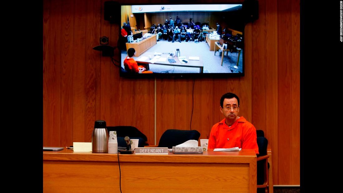 "Larry Nassar, a former team doctor for USA Gymnastics and Michigan State University, listens during another one of his sentencing hearings, <a href=""https://www.cnn.com/2018/01/31/us/larry-nassar-sentencing-eaton-county-michigan/index.html"" target=""_blank"">his third in recent months,</a> on Wednesday, January 31. Nassar <a href=""https://www.cnn.com/2018/01/24/us/larry-nassar-sentencing/index.html"" target=""_blank"">had already been sentenced to 40 to 175 years in prison</a> after more than 150 women and girls said in court that he sexually abused them over the past two decades. He also pleaded guilty to child pornography charges in December and was sentenced to 60 years in prison."