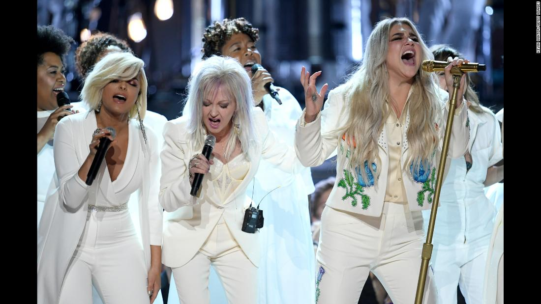 "Kesha gives an emotional performance of ""Praying"" at the Grammy Awards on Sunday, January 28. She was backed up by singers including Bebe Rexha, Cyndi Lauper, Camila Cabello, Andra Day and Julia Michaels. <a href=""https://www.cnn.com/2018/01/28/entertainment/kesha-grammy-performance-2018/index.html"" target=""_blank"">Read more: The Grammys' #MeToo moment</a>"