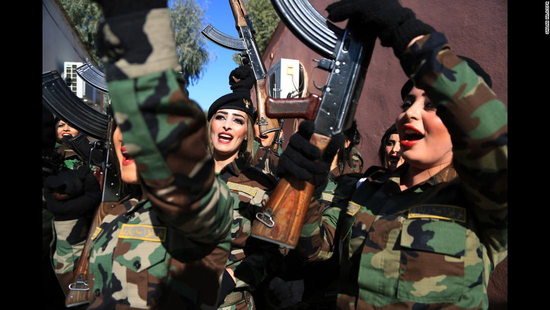 Female Peshmerga fighters celebrate Tuesday, January 30, after graduating from a military academy in Zakho, Iraq. The Peshmerga are the national military force for the Kurdistan Regional Government in northern Iraq.