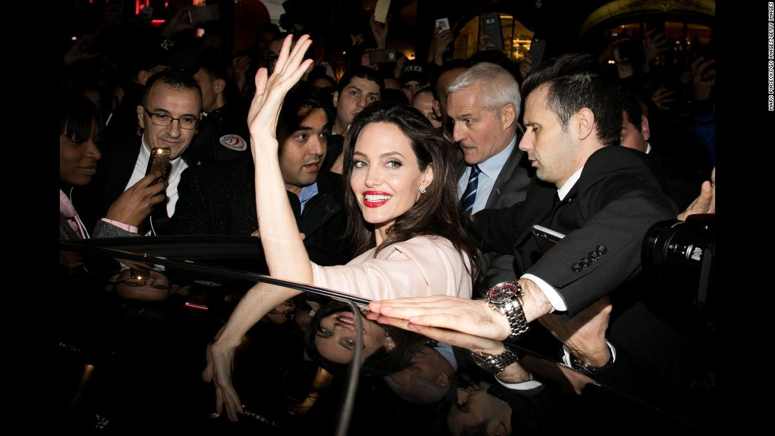 Actress Angelina Jolie waves after leaving a store in Paris on Tuesday, January 30.
