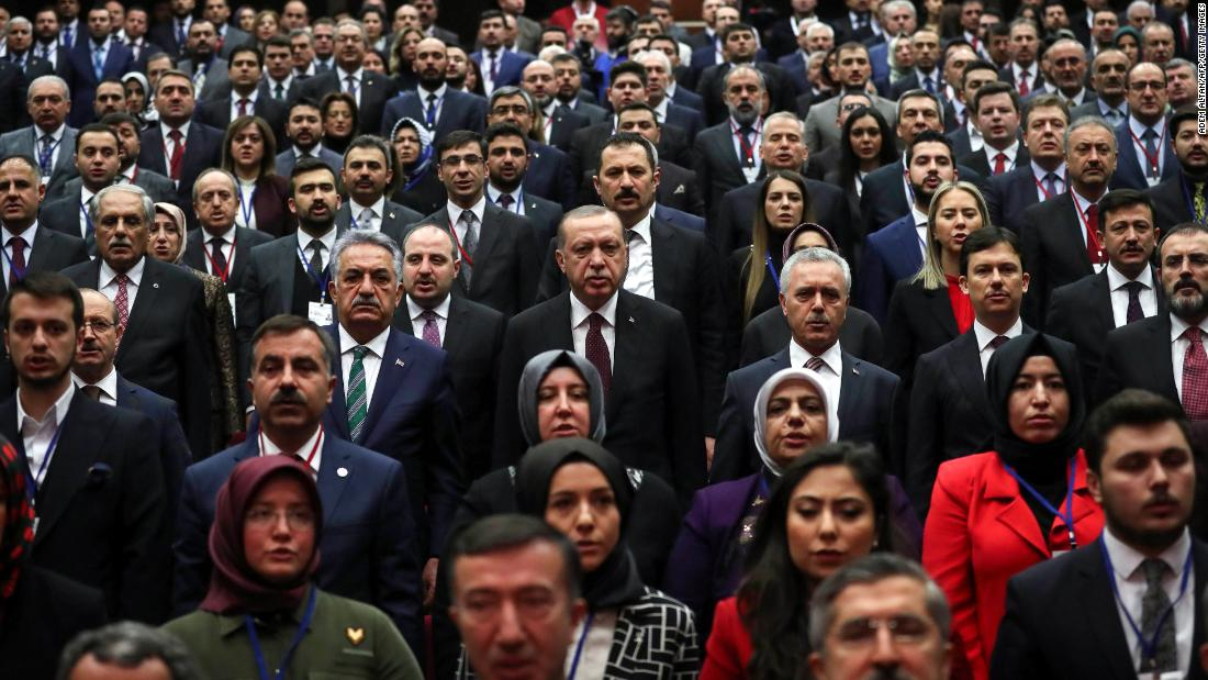 Turkish President Recep Tayyip Erdogan, at center next to the man in the green tie, attends a meeting of the AKP party in Ankara on Friday, January 26.