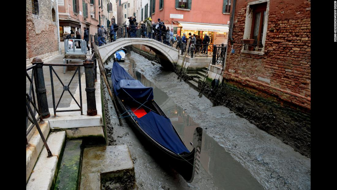 A gondola is tied up in Venice, Italy, on Wednesday, January 31, after unusually low tides caused a record-low water level in the city.