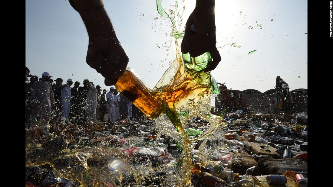 A Pakistani customs official smashes liquor bottles in Karachi on Friday, January 26.