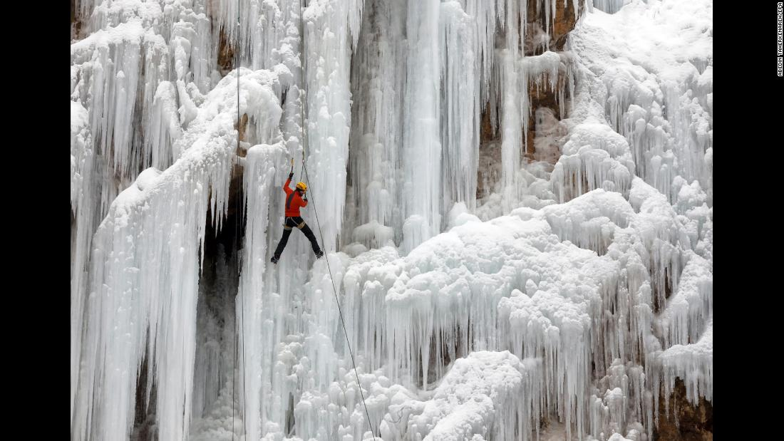 An ice climber scales a frozen waterfall in the Iranian village of Meygun on Friday, January 26.