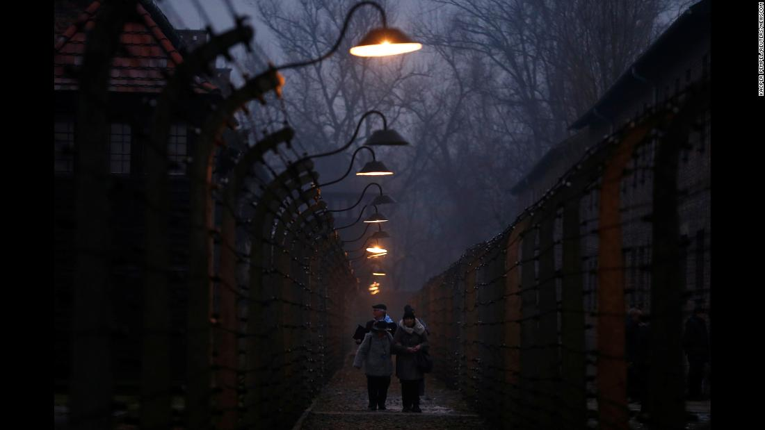 "People walk inside the barbed-wire fences at what used to be the Nazi concentration camp Auschwitz on Saturday, January 27. It was International Holocaust Victims Remembrance Day. <a href=""http://www.cnn.com/2018/01/19/world/gallery/week-in-photos-0119/index.html"" target=""_blank"">See last week in 24 photos</a>"