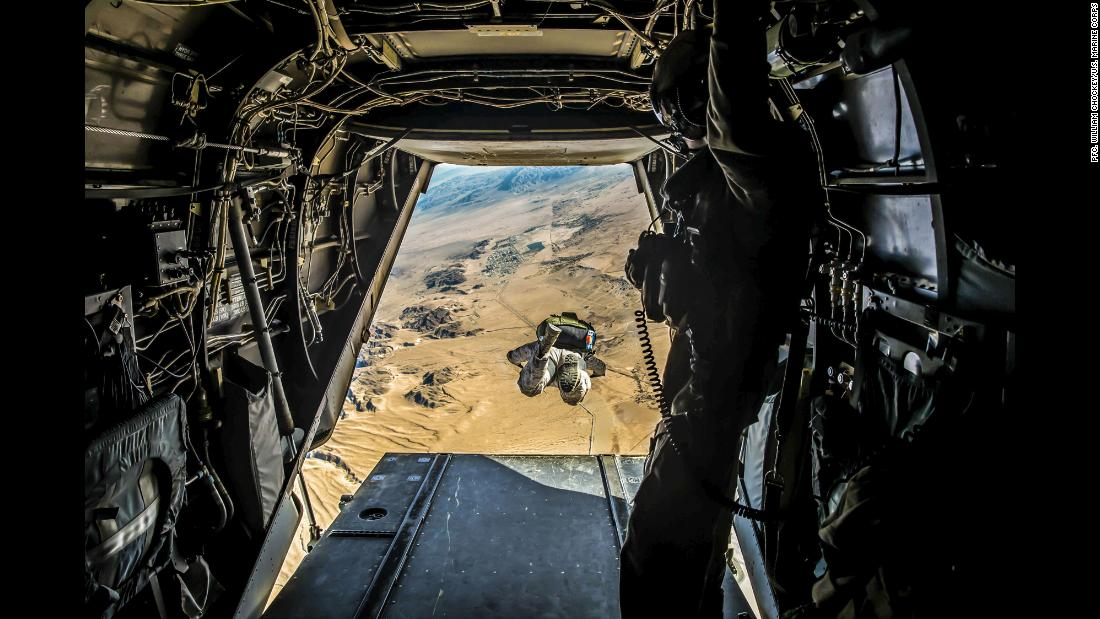 A Marine jumps out of an MV-22 Osprey during a training exercise at Marine Corps Air Ground Combat Center in Twentynine Palms, California, on Thursday, January 18.